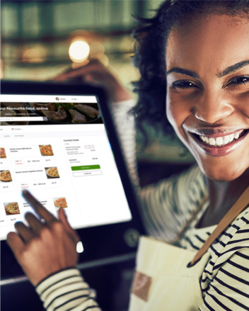 Woman server using Moduurn app to manage orders